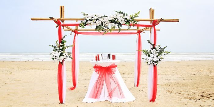bamboo archway with red tulle